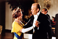 President Gerald Ford dancing with Queen Elizabeth II during a State Dinner held in her honor.  7 July 1976