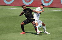 LOS ANGELES, CA - AUGUST 22: Diego Palacios #12 of LAFC and Julian Araujo #22 of the Los Angeles Galaxy battle for a loose ball during a game between Los Angeles Galaxy and Los Angeles FC at Banc of California Stadium on August 22, 2020 in Los Angeles, California.
