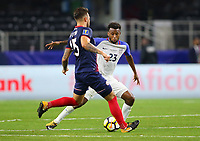 ARLINGTON, TEXAS - Saturday July 22, 2017: Kellyn Acosta #23 of USMNT defends the ball against Francisco Calvo #15 of Costa Rica National Team in the second half of the match at AT&T Stadium.