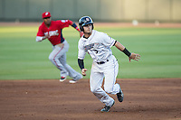 Adam Engel (5) of the Winston-Salem Dash takes off for third base during the game against the Potomac Nationals at BB&T Ballpark on May 13, 2016 in Winston-Salem, North Carolina.  The Dash defeated the Nationals 5-4 in 11 innings.  (Brian Westerholt/Four Seam Images)