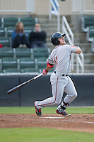 Michael Chavis (11) of the Greenville Drive follows through on his swing against the Kannapolis Intimidators at CMC-Northeast Stadium on April 28, 2015 in Kannapolis, North Carolina.  The Intimidators defeated the drive 3-2.  (Brian Westerholt/Four Seam Images)