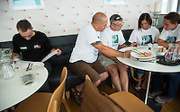 26 SEP 2013 - LANDS END, GBR - Andy Moore (left) and Judith Martin (second from the right) and her support crew study the race route maps at the race briefing before the start of the Enduroman 2013 Lands End to London to Dover ultra triathlon at Lands End, Sennen, Cornwall, Great Britain (PHOTO COPYRIGHT © 2013 NIGEL FARROW, ALL RIGHTS RESERVED)