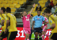 Referee Jonathan Kaplan penalises the Hurricanes during the Super Rugby match between the Hurricanes and Waratahs at Westpac Stadium, Wellington, New Zealand on Saturday, 6 April 2013. Photo: Dave Lintott / lintottphoto.co.nz