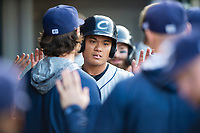 Columbus Clippers second baseman Yu Chang (6) is congratulated by teammates after scoring a run during an International League game against the Indianapolis Indians on April 29, 2019 at Victory Field in Indianapolis, Indiana. Indianapolis defeated Columbus 5-3. (Zachary Lucy/Four Seam Images)