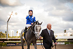 HALLANDALE FL - FEBRUARY 27: Mohaymen #6, ridden by Junior Alvarado is lead into the winners circle by Rick Nichols after winning the Xpressbet.com Fountain of Youth Stakes at Gulfstream Park on February 27, 2016 in Hallandale, Florida.(Photo by Alex Evers/Eclipse Sportswire/Getty Images)