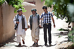 8 June 2013, Mula Sultan village, Kholm District , Mazar-i-Sharif, Balkh Province, Afghanistan. Local farmer Sayed Ahmed (centre) speaks with Ahmad Fahim Jabri (right) from the Horticulture and Livestock program and farmer Addullah Samadi (left) on his orchard at  Mula Sultan village, Kholm District. He is growing pomegranates, almonds and figs. Mr.Ahmed is bagging his pomegranate fruit to prevent pests destroying his crop. Mr. Shah  is benefitting from the new National Horticulture and Livestock Project (NHLP). The trees are part of a re-generation program that allows him to access Farmers Field School that teaches better growing techniques, fertilising methods and marketing of his fruit. His production output has grown from a paltry 20% to something near 80% as a result of the NHLP. The NHLP is providing training and equipment to farmers to assist in increasing production and to improve management of lands and animals. Picture by Graham Crouch/World Bank