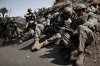 US Army Soldiers from Viper Company 126, 2nd Platoon, run for cover and call in artillery support after being attacked on a foot patrol near Atabad in the restive Korengal Valley. The patrol was to meet with key tribal leaders in the village. After discussions and tea with the tribal elders they received intelligence of an imminent attack.