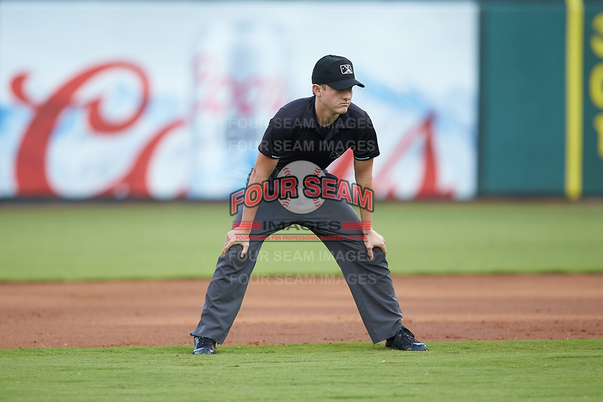 Second base umpire Trevor Matthews works the Appalachian League playoff game between the Burlington Royals and the Pulaski Yankees at Calfee Park on September 1, 2019 in Pulaski, Virginia. The Royals defeated the Yankees 5-4 in 17 innings. (Brian Westerholt/Four Seam Images)