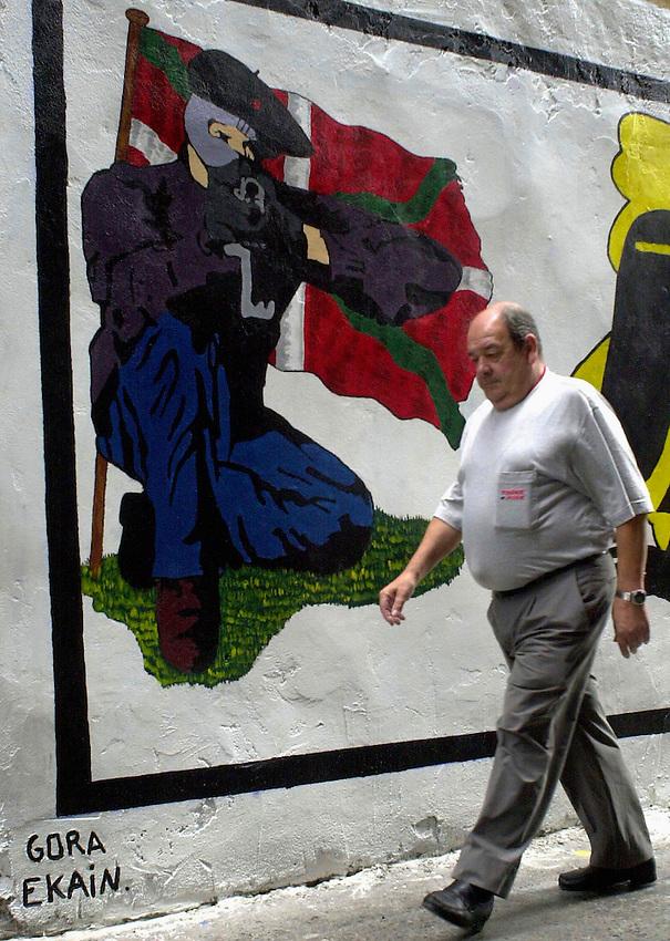 A man walks past near a graffiti in support of ETA died member ekain ruiz in Hernani.<br /> Photo: Ander Gillenea