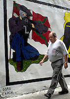 A man walks past near a graffiti in support of ETA died member ekain ruiz in Hernani.<br /> Photo: Ander Gillenea