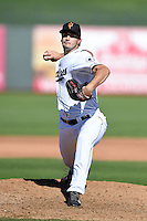 Surprise Saguaros pitcher Burch Smith (52) during an Arizona Fall League game against the Scottsdale Scorpions on October 11, 2014 at Surprise Stadium in Surprise, Arizona.  Scottsdale defeated Surprise 7-6.  (Mike Janes/Four Seam Images)
