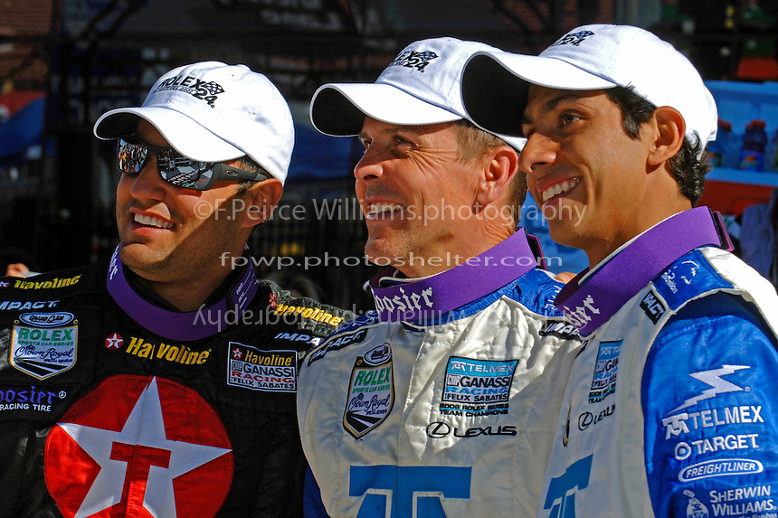 Race winners Juan Pablo Montoya, Scott Pruett and Salvador Duran celebrate in Victory Lane.