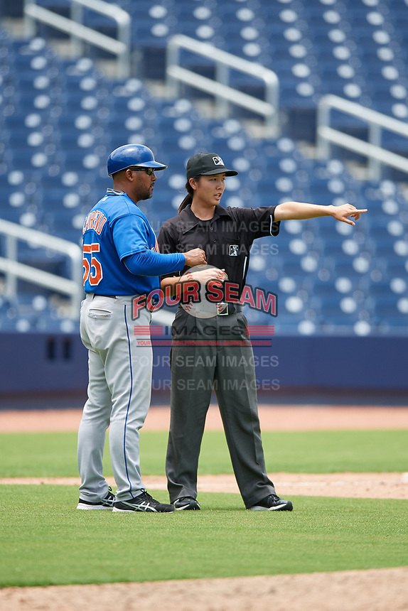 GCL Mets Jose Carreno (55) talks with first base umpire Emma Charlesworth-Seiler during the second game of a doubleheader against the GCL Nationals on July 22, 2017 at The Ballpark of the Palm Beaches in Palm Beach, Florida.  GCL Mets defeated the GCL Nationals 4-1.  (Mike Janes/Four Seam Images)