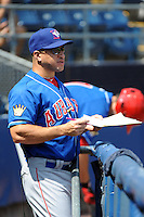 Auburn Doubledays coach Luis Ordaz (19) during game against the Staten Island Yankees at Richmond County Bank Ballpark at St.George on August 2, 2012 in Staten Island, NY.  Auburn defeated Staten Island 11-3.  Tomasso DeRosa/Four Seam Images