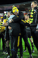 Scrum coach Dan Cron hugs James Broadhurst after the Super Rugby final match between the Hurricanes and Lions at Westpac Stadium, Wellington, New Zealand on Saturday, 6 August 2016. Photo: Dave Lintott / lintottphoto.co.nz