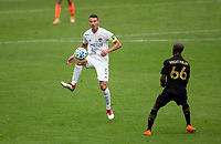 LOS ANGELES, CA - OCTOBER 25: Daniel Steres #5 of the Los Angeles Galaxy traps a ball during a game between Los Angeles Galaxy and Los Angeles FC at Banc of California Stadium on October 25, 2020 in Los Angeles, California.