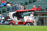 Rochester Red Wings bullpen car during a pitching change where the reliever opted to jog into the game instead of hitch a ride against the Columbus Clippers on May 12, 2013 at Frontier Field in Rochester, New York.  Rochester defeated Columbus 5-4 wearing special pink jerseys for Mother's Day.  (Mike Janes/Four Seam Images)