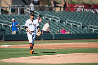 Salt River Rafters starting pitcher Jordan Yamamoto (20), of the Miami Marlins organization, walks towards the mound during an Arizona Fall League game against the Surprise Saguaros at Salt River Fields at Talking Stick on November 5, 2018 in Scottsdale, Arizona. Salt River defeated Surprise 4-3 . (Zachary Lucy/Four Seam Images)