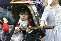 Johnathan Irizarry, visiting from Ft. Bragg, NC, guards his stroller while participating in the 11th annual Jeffersonian Thanksgiving Festival Saturday in Charlottesville, Va. The festival is free and lasts through Nov. 27. kids dress up