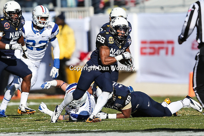 Navy Midshipmen running back Marcus Thomas (26) in action during the Armed Forces Bowl game between the Middle Tennessee Blue Raiders and the Navy Midshipmen at the Amon G. Carter Stadium in Fort Worth, Texas. Navy defeated Middle Tennessee 24 to 6.