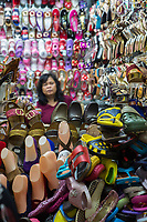 Yogyakarta, Java, Indonesia.  Shoe Store and Clerk, Beringharjo Market.