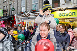 Darragh Maguire on his dad Shane's shoulders giving Santa a big wave at the CH Chemist's Santa Parade on Saturday