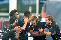 FOXBOROUGH, MA - SEPTEMBER 23: Henry Kessler #4 of New England Revolution celebrates his goal with teammates during a game between Montreal Impact and New England Revolution at Gillette Stadium on September 23, 2020 in Foxborough, Massachusetts.
