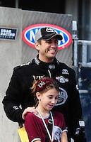 Sept. 25, 2011; Ennis, TX, USA: NHRA top fuel dragster driver Larry Dixon with daughter Alanna Dixon during the Fall Nationals at the Texas Motorplex. Mandatory Credit: Mark J. Rebilas-