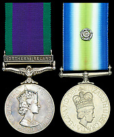 BNPS.co.uk (01202 558833)<br /> Pic: DNWAuctions/BNPS<br /> <br /> The medals won by the SAS hero who captured the only terrorist to survive the Iranian Embassy siege have been put up for sale.<br /> <br /> Sergeant Ivor Pape detained Fowzi Nejad in the garden of the London embassy as the terrorist tried to pass himself off as a hostage.<br /> <br /> A photo of the member of the elite special forces unit shows him kneeling over Nejad as he lay prostrate on the ground.<br /> <br /> Nejad, whose five terrorist pals were shot dead when the SAS stormed the building in 1980, served 28 years in jail.<br /> <br /> Controversially, he couldn't be deported to Iran upon his release from prison because it would have breached his human rights. He is now said to live in a tax-payer funded house in south London.