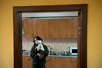 Tanya, Scharfschuetzin der pro-russischen Separatisten, Portrait, Donezk, Ukraine, 10.2014,  Tanya, 19-years old girl, the sniper of the pro-Russian militia swith her dog Bonie in a barracks of her unit at the suburb of Donetsk.  ***HIGHRES AUF ANFRAGE*** ***VOE NUR NACH RUECKSPRACHE***