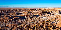 Atacama Desert in sunrise light on El Valle de la Luna (Moon Valley) with colorful dunes and salt, under a blue sky, near San Pedro de Atacama, Chile