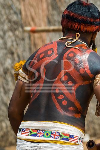 Xingu Indigenous Park, Mato Grosso State, Brazil. Aldeia Afukuri (Kuikuro). Festival of Taquara; warrior wearing a beaded belt with the flags of many nations.