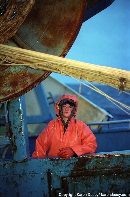Deckhand Tiffane Scarlatos on the F/V Progress, a dragger, also known as a trawler, fishes for pollock in the Bering Sea.