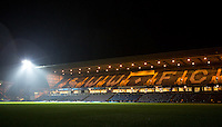 General view as the first floodlight goes on during the Sky Bet League 2 match between Wycombe Wanderers and Notts County at Adams Park, High Wycombe, England on 15 December 2015. Photo by Andy Rowland.
