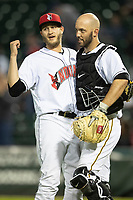 Dovydas Neverauskas (30) of the Indianapolis Indians celebrates with catcher Jacob Stallings (32) after the game at Victory Field on May 14, 2019 in Indianapolis, Indiana. The Indians defeated the RailRiders 4-2. (Andrew Woolley/Four Seam Images)