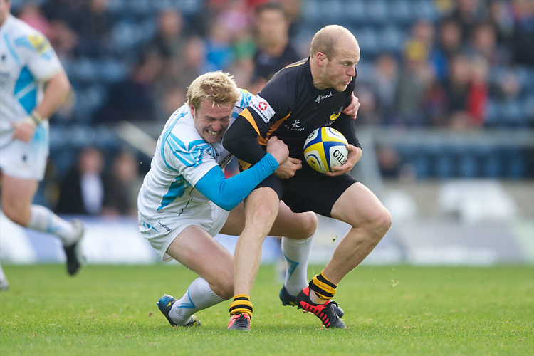 Joe Simpson of London Wasps is tackled by Joe Carlisle of Worcester Warriors during the Aviva Premiership match between London Wasps and Worcester Warriors at Adams Park on Sunday 7th October 2012 (Photo by Rob Munro)
