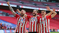 Pontus Jansson, Charlie Goode and Vitaly Janelt celebrate winning the Championship Trophy and promotion to the Premier League during Brentford vs Swansea City, Sky Bet EFL Championship Play-Off Final Football at Wembley Stadium on 29th May 2021