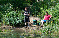 Ardingly, ENGLAND. 25.05.2020<br /> .<br /> Two men fishing while enjoying the sun during the bank holiday Monday Covid-19 lockdown with government guidelines to social distance  at Ardingly Reservoir, Ardingly, West Sussex, England at  on 25 May 2020. Photo by Alan Stanford.
