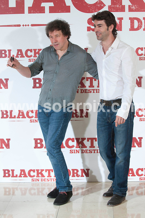 """**ALL ROUND PICTURES FROM SOLARPIX.COM**                                             **WORLDWIDE SYNDICATION RIGHTS EXCEPT SPAIN - NO SYNDICATION IN SPAIN**                                                                                  Madrid. Spain. Princesa Cinema. .Irish actor Stephen Rea, the Spanish actor Eduardo Noriega and the director Mateo Gil attend the photocall for new movie """"Blackthorn: Without Detiny""""                                                                         .This pic:     Stephen Rea, & Eduardo Noriega                                                                                        JOB REF:    13636    DMS       DATE:   28.06.11                                                         **MUST CREDIT SOLARPIX.COM OR DOUBLE FEE WILL BE CHARGED**                                                                      **MUST AGREE FEE BEFORE ONLINE USAGE**                               **CALL US ON: +34 952 811 768 or LOW RATE FROM UK 0844 617 7637**"""