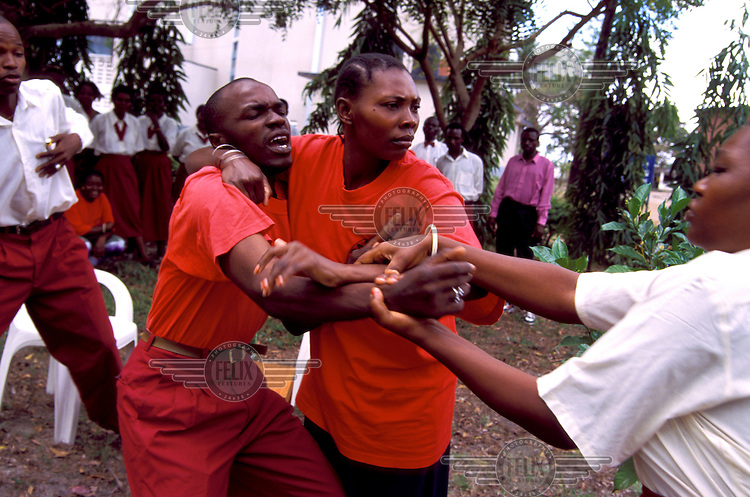AIDS awareness group acting out a drama aimed at describing the dangers of HIV to slum dwellers and school children, at the POSADA clinic.