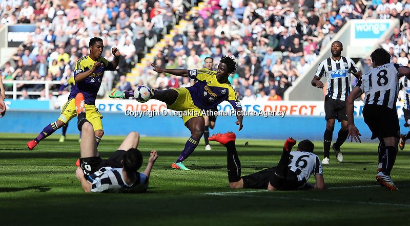 Pictured: Wilfried Bony of Swansea (C) takes a shot at goal only to be ruled off side. Saturday 19 April 2014<br /> Re: Barclay's Premier League, Newcastle United v Swansea City FC at St James Park, Newcastle, UK.