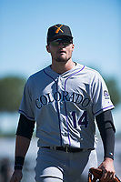 Salt River Rafters right fielder Sam Hilliard (14), of the Colorado Rockies organization, walks off the field between innings of an Arizona Fall League game against the Surprise Saguaros on October 9, 2018 at Surprise Stadium in Surprise, Arizona. The Rafters defeated the Saguaros 10-8. (Zachary Lucy/Four Seam Images)