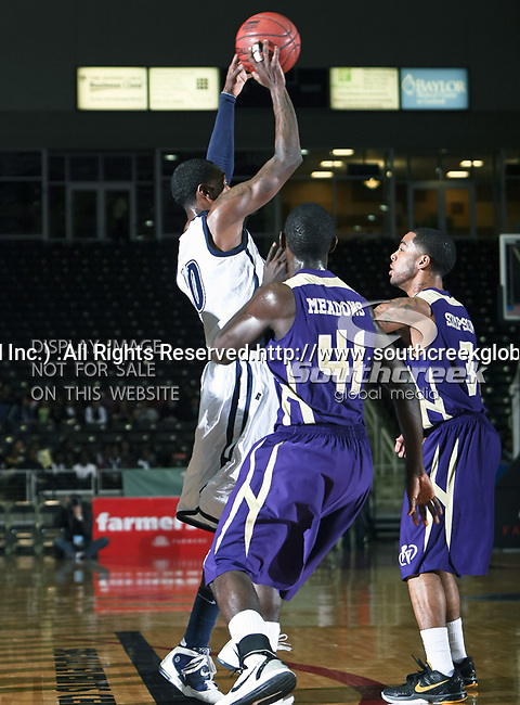 Jackson State Tigers guard/forward Tyrone Hanson (10) and Prairie View A & M Panthers guard Tim Meadows (41) in action during the SWAC Tournament game between the Prairie View A & M Panthers and the Jackson State Tigers at the Special Events Center in Garland, Texas. Jackson State defeats Prairie View A & M 50 to 38.