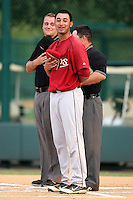 Houston Astros shortstop Jiovanni Mier sings the national anthem in front of umpires Ron Teague (left) and Mike Cascioppo (hidden) before an Instructional League game against the Atlanta Braves at Wide World of Sports on September 28, 2011 in Kissimmee, Florida.  (Mike Janes/Four Seam Images)