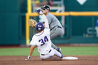 Vanderbilt Commodores second baseman Tyler Campbell (2) turns a double play as TCU baserunner Garrett Crain (34) slides into second base during the NCAA College baseball World Series against the TCU Horned Frogs on June 16, 2015 at TD Ameritrade Park in Omaha, Nebraska. Vanderbilt defeated TCU 1-0. (Andrew Woolley/Four Seam Images)