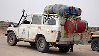 Khalil, a settlement on the border between Mali and Algeria, in the middle of the desert. This car is used to ferry migrants across the border illegally.