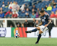 FOXBOROUGH, MA - JULY 17: Gustavo Bao #7 passes the ball during a game between Vancouver Whitecaps and New England Revolution at Gillette Stadium on July 17, 2019 in Foxborough, Massachusetts.