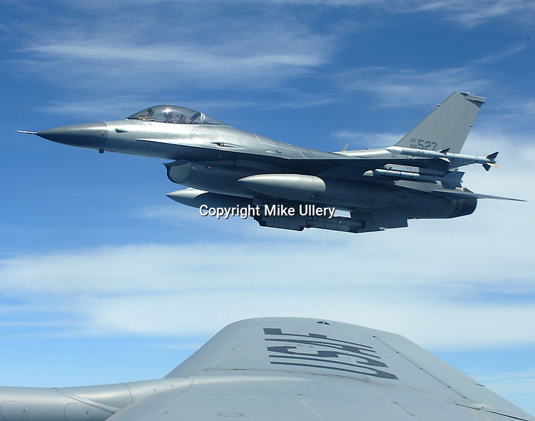 Staff Photo/Mike Ullery, Piqua Daily Call.An F-16 from the Ohio National Guard's 180 Fighter Wing out of Toledo, Ohio flies on the wing of a KC-135 tanker belonging to the 121st Air Refueling Wing from Rickenbacker Air National Guard Base in Columbus, Ohio on July 16, 2009. The media flight originated out of Rickenbacker with the aircraft joining up over the northern part of Michigan for the refueling exercise.