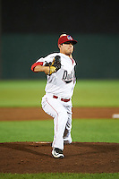 Auburn Doubledays relief pitcher Jonny Reid (13) during a game against the Tri-City ValleyCats on August 25, 2016 at Falcon Park in Auburn, New York.  Tri-City defeated Auburn 4-3.  (Mike Janes/Four Seam Images)