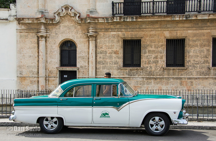 Havana, Cuba - A rental car near Plaza de la Catedral. Classic American cars from the 1950s, imported before the U.S. embargo, are commonly used as rentals and taxis in Havana.